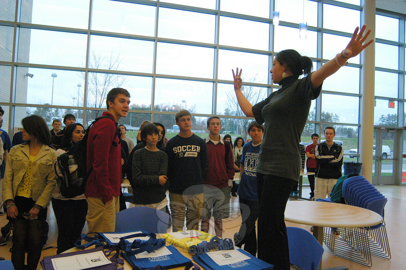 Newtown High School teacher and Executive Class Council advisor Elizabeth Wardde Leon gave NHS Executive Class Council members from multiple grades their marching orders, before students sorted and assembled bags of goods for 16 local families on Tuesday, November 22.  (Hallabeck photo)