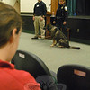 Officer Matthew Hayes, left, and Police K-9 Officer Felicia Figol with German shepherd Baro, spoke to eighth grade students during the school's Career Day on Friday, November 18.  (Hallabeck photo)