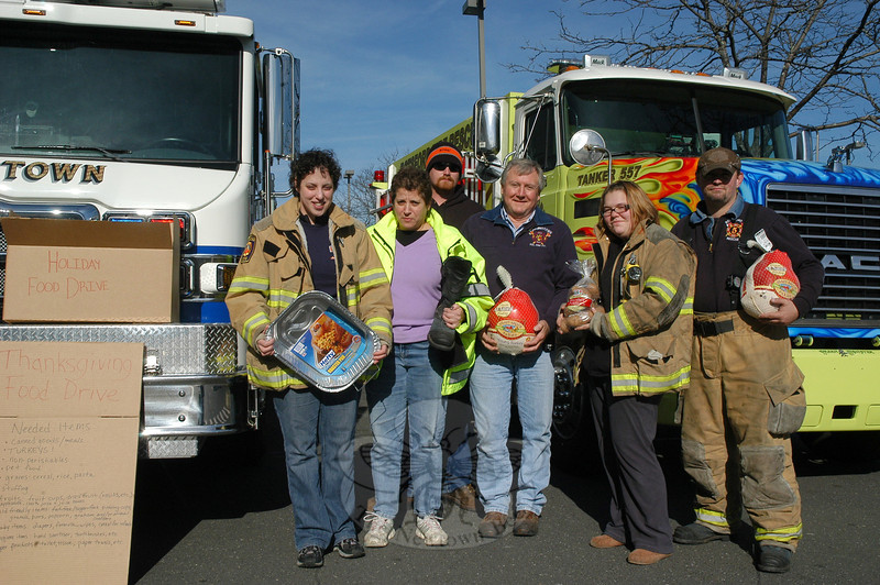 Members of the Dodgingtown and Botsford volunteer fire companies participated in the Fill The Fire Truck project, which is a food drive for the needy, on Saturday, November 19, in front of the Stop & Shop supermarket at Sand Hill Plaza on South Main Street.  (Gorosko photo)