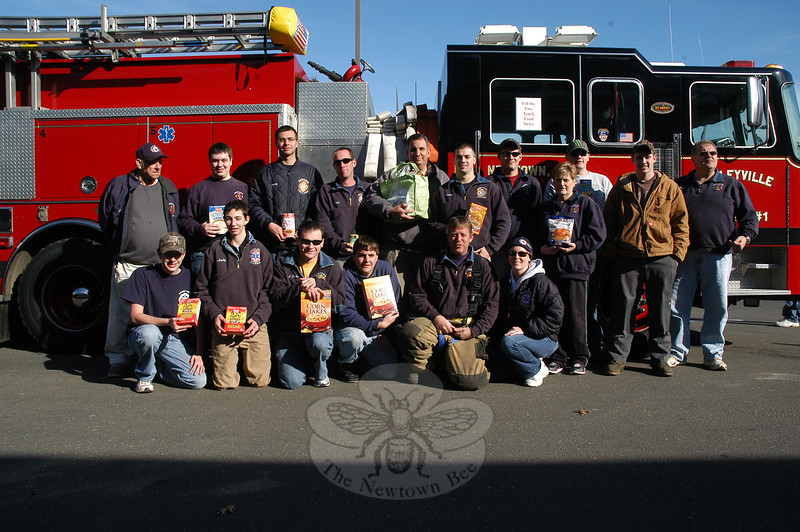 Newtown Hook & Ladder, Sandy Hook, and Hawleyville volunteer fire company members were stationed in front of the Big Y supermarket at Newtown Shopping Village on Queen Street on Saturday, November 19, in the Fill The Fire Truck project, in which they collected food for the needy.  (Gorosko photo)