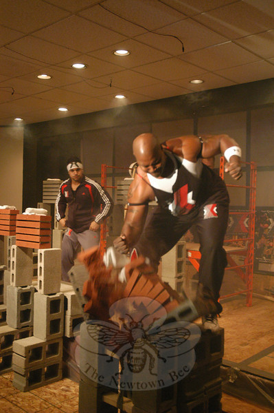 Greg Graham, a member of Xtreme Impact, performs a feat of strength in breaking multiple bricks at the evangelical group's performance held on November 18 at Grace Christian Fellowship at 174 Mt Pleasant Road in Hawleyville.  (Gorosko photo)
