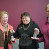 Marjorie Vrabel, center, Salvation Army service extension field representative, stands with Marie Sturdevant, left, and Sylvia Poulin. Mrs Sturdevant and Mrs Poulin were recently recognized with crystal bells for more than two decades of volunteer work for The Salvation Army.  (Hicks photo)