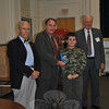 Pat Caruso, president of the Newtown Rotary Club, presents a dictionary to Zachary Loomis, a fourth grade student in Michael Wight's class at Hawley School, Monday, November 21. Newtown Rotary Club Sergeant At Arms Mike Snyder, left, and past president Brian Amey look on. The Rotary Club donates dictionaries to every fourth grade student, districtwide, each year.  (Crevier photo)