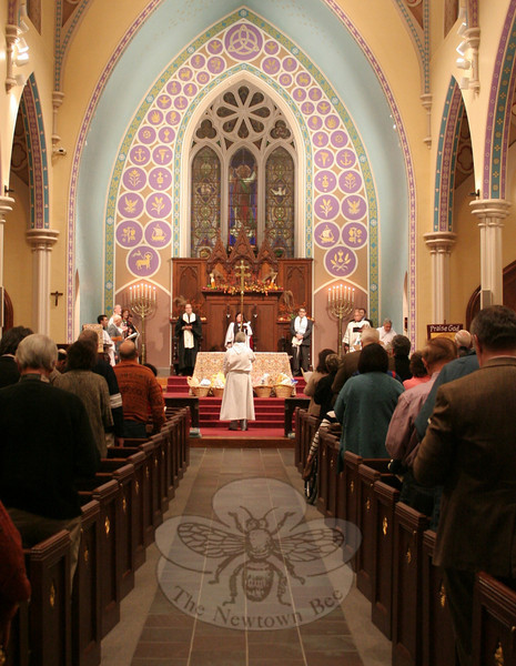 "Participating clergy prepare to leave the altar while attendees sang ""O Beautiful For Spacious Skies,"" the evening's closing hymn.  (Hicks photo)"