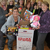 Realtors from William Pitt Sotheby's International Realty, 34 Church Hill Road, display some of the toys that have already been donated to the US Marine Corps Reserve Toys For Tots program. William Pitt Sotheby's is one of several drop-off points in Newtown for the annual drive to collect new, unwrapped toys for distribution to less fortunate children in the community. Pictured from left of box are Tina Wessel, Glynis Sharp, Brigitta Cole, Lisa DeVellis, Susan Corleto, Necole Salvesen, Linda Whipkey, Karen Michel, and Jane Phillips. Toys for children ages newborn to teen are appreciated.  (Crevier photo)