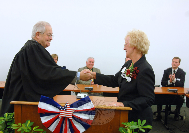 State Appellate Court Judge William Lavery, a longtime Newtown resident, shook hands with First Selectman Pat Llodra, welcoming her to her second term as Newtown's top official during a swearing in ceremony on Sunday, November 27.  (Bobowick photo)
