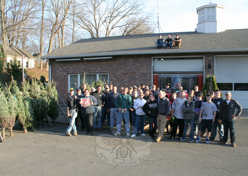 Sandy Hook Volunteer Fire & Rescue Co. received a delivery of 500 Christmas trees on No-vember 25, and company members have begun their annual holiday fundraiser. Christmas trees (balsam and frasers, from six-foot to cathedral height), pine roping, wreaths (12-, 16- and 18-inch), cemetery boxes, kissing balls, tree stands, and even tree bags to help make cleanup easier are all available daily at the fire company's main station, 18-20 Riverside Road. Members are at the firehouse Monday through Friday from 6 to 9 pm (by chance during the day), and weekends from 9 am until 9 pm. Proceeds from the annual sale benefit the fire company.  (Hicks photo)