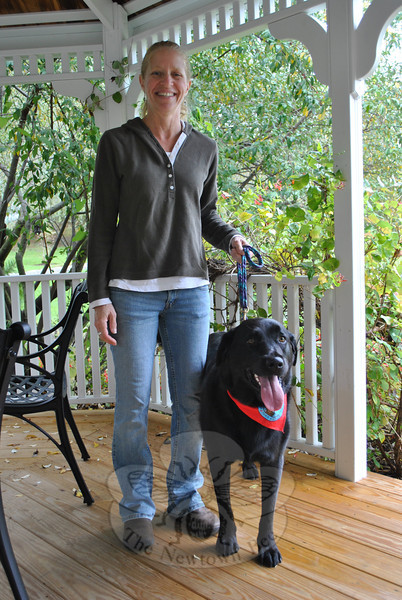 Becky Dvorin says her 80-pound Labrador, Ella, is particularly empathetic, making the large dog a sensitive and ideal therapy pet.  (Crevier photo)