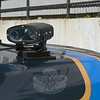 This electronic surveillance camera is one of the two cameras that police mount on the trunk of a police car to scan the marker plates of motor vehicles to learn whether those vehicles' plates are linked to any pending motor vehicle and/or criminal violations.  (Gorosko photo)