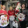 The VNA Thrift Shop at Edmond Town Hall will be open during its regular Saturday hours of 9 am until at least noon on December 3, but shoppers will find an especially big supply of holiday items if they stop in that morning. Anna Wiedemann, Mae Schmidle, and Toni Catalina, from left, were at the shop recently, organizing some of the items that will be offered during the special VNA Christmas Boutique this weekend. There will be plenty of Christmas gifts and holiday items as well as the regular offerings of clothing and small home accessories and decorations customers count on at the shop operated by the local Visiting Nurses Association. Entry is from the lower rear parking lot of the town hall, 45 Main Street. (Hicks photo)
