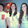 Newtown High School juniors, from left, Taylor Rutter, Sam Steimle, and Gracie Whitaker are shown wearing T-shirts they designed for the school's celebration of French week. After designing T-shirts, students also entered into T-shirt contests on Monday, December 5, ate student-made French food, and reviewed posters created by other students in each level of the French curriculum at NHS. Students in the different levels of the program studied French provinces, French mathematicians and scientists, French musicians and more.  (Hal-labeck photo)