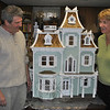 Pat Napolitano, left, and his wife C.G. are pleased that nearly 500 hours of work by Mr Napolitano has paid off in a beautiful dollhouse that they will give to their twin grandchildren this month.  (Crevier photo)
