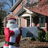 Santa Claus visited The Newtown Bee's office on December 1, just in time to sell the December 2, 2011 print edition as it came off the presses. He promises to return each Thursday afternoon until Christmas to greet those who want to stop by 5 Church Hill Road.  (Hicks photo)
