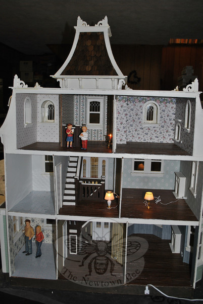 The completed nine-room doll house is fully wired, with an outlet in every room. Furnishings will be completed, bit by bit, as gifts from friends and relatives.  (Crevier photo)