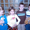 During a playdate between four Head O' Meadow students — from left, Caroline Moran, Kristin Lageman, Dante Verna, and Brian Lageman — in October the students raised money to adopt an animal through the World Wildlife Fund. On Monday, December 5, the students gathered together at their school to reflect on their accomplishment.  (Hallabeck photo)