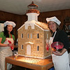 Laura McNamara, left, and Donna Ball stand with Sugar Cookie Sheffield Island, their entry for the 10th Annual Festival of Lighthouses. The construction features hundreds of hand cut sugar cookies re-creating the historic lighthouse in Long Island Sound. It is one of two entries in this year's Maritime Aquarium event from Newtown.  (Hicks photo)