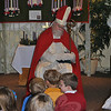 St Nicholas, the Bishop of Myra, snoozes as children wait for him to awaken and share a story, Saturday morning, December 3, at Trinity Episcopal Church. The special visitor was part of a learning experience for the church children about St Nicholas Day.  (Crevier photo)