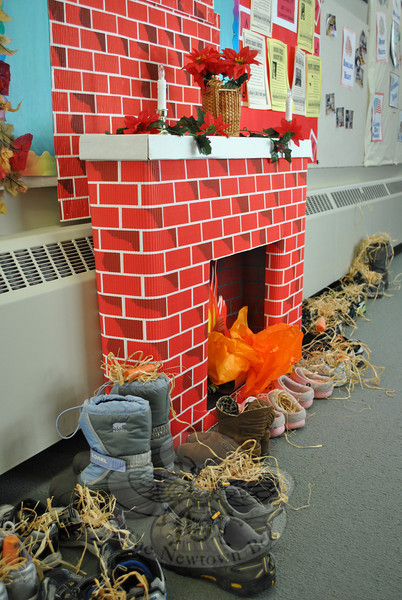 """Shoes left by the """"fireplace"""" in the Trinity Episcopal undercroft are filled with hay and carrots, in the Dutch tradition, for St Nicolas's horse. Children hope to find candy replacing the offerings when they return.  (Crevier photo)"""