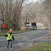 Miriam Garcia was one of two traffic control officers slowing or sometimes temporarily stopping traffic on Sunday, December 4, while a tree crew that had been contracted by the state worked to clear brush along Berkshire Road. The brush had been piled up since shortly after the October 29-30 Nor'easter.  (Hicks photo)
