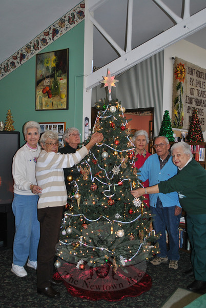Members of the Newtown Senior Center held a tree decorating party, Friday, December 2, at the Riverside Road Senior Center. Trimming the tree from left are Rachel Plude, Rose Lindmark, Barbara Mitchell, Heidi Roesch, Frank Furze, and Luella Dwyer.  (Crevier photo)
