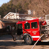 Sandy Hook Second Assistant Fire Chief Michael Burton, left, and Sandy Hook Hydro, LLC, proprietor Rick Fattibene, Jr, on ladder, check for evidence of fire at the point where a five-foot-diameter water pipe enters a small hydroelectric plant at Rocky Glen Mill at 75 Glen Road in Sandy Hook midday on December 1. Welding repairs on the water pipe resulted in a small fire at the 19th Century building, which is used as an office complex.  (Gorosko photo)