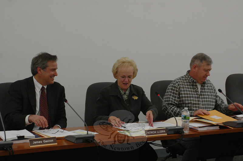 James Gaston, Sr, far left, settles into a familiar chair in his new capacity as selectman along with First Selectman Pat Llodra and fellow Selectman Will Rodgers on Monday, December 5. The former Board of Finance vice chairman joked that he had occupied the same seat in Newtown's municipal council chambers during his previous term of elected service with the finance board.  (Voket photo)