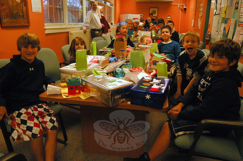 Members of Hawley School's Kids Care Club met after school on Tuesday, December 6, to package holiday gifts to send to Ghana, Africa, through the Haven Children Orphanage, based out of West Haven.  (Hallabeck photo)
