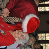"""""""Santa"""" Kevin Parker gives Newtown Senior Center member Florence DePalma a hug and a kiss, as he makes his way from table to table during the Tuesday afternoon holiday party at Capellaro's Grove in Bethel.  (Crevier photo)"""