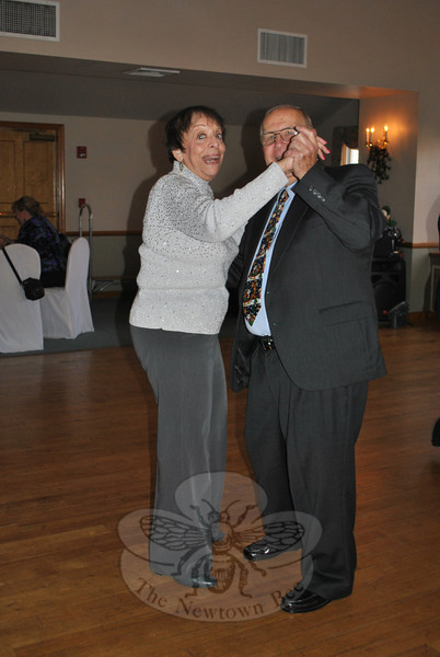 Phyllis Fives and Bill Thiessen enjoy a spin around the dance floor at Capellaro's Grove in Bethel, where members and friends of the Newtown Senior Center gathered for a holiday party on Tuesday, December 13.  (Crevier photo)