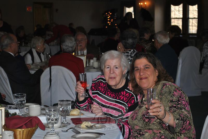 Martha, left,  and Ellen Porubanik raise a toast to the season at the Newtown Senior Center Holiday Party, Tuesday, December 13.  (Crevier photo)