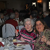 Martha, left,  and Ellen Porubanik raise a toast to the season at the Newtown Senior Center Holiday Party, Tuesday, December 13.  (Crevier photo)