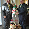 "Newtown Savings Bank CEO John Trentacosta, left, is pleased to accept a donation of doz-ens of toys from Howard Lasher, Monday, December 12, for the US Marine Corps Toys For Tots program. Mr Lasher and his wife Jeanette Hubley-Lasher filled three large garbage bags with new, stuffed animals to bring cheer to local children this holiday season. ""It's a privilege to be part of a community where everyone gives and cares for each other, as they do in Newtown, and Newtown Savings Bank certainly is a part of that, too,"" says Mr Lasher. Toys For Tots collection points are located in all Newtown Savings Bank sites, as well as at numerous other businesses in town. A sign designating a place as a drop-off site for Toys For Tots is generally posted out front of the business.  (Crevier photo)"