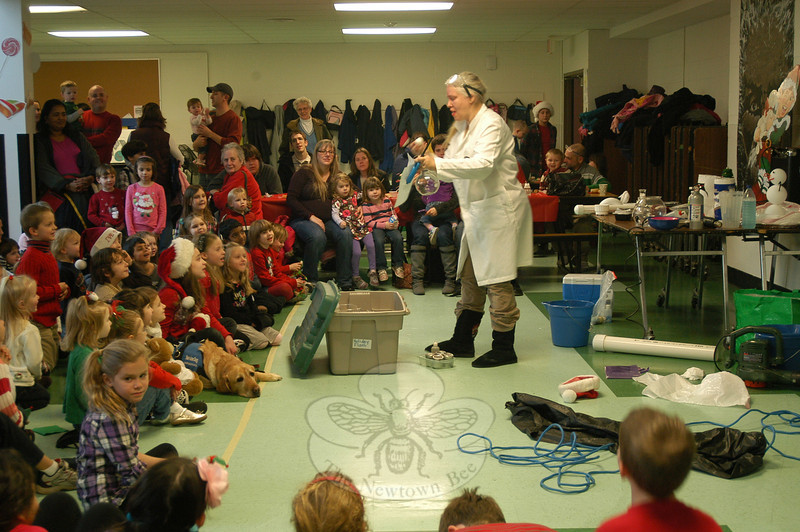 Juniper Jess perform as a mad scientist for children attending the Parks and Recreation Department's Annual Breakfast With Santa Newtown at Newtown Middle School on Saturday, December 10.  (Hallabeck photo)