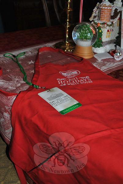 "A work apron and name tag are the only mementos of Maria Obolewicz's stint as a White House holiday decorator, but she has ""a treasure chest of memories.""  (Crevier photo)"