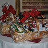 A 50/50 raffle, a handmade Christmas afghan, and these two gift baskets were all part of the gifts sent home with some lucky winners following Newtown Senior Center's Annual Christmas Party on December 13.  (Crevier photo)