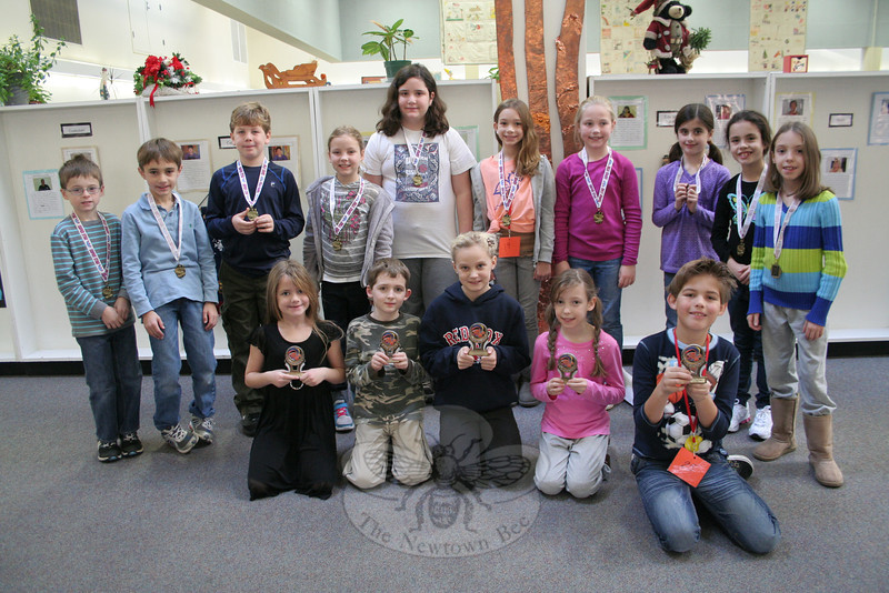 First place winners in the PTA-sponsored Reflection Program at Head O' Meadow this year were recognized with trophies. All other participants in the contest were recognized with medals on Tuesday, December 13. From left, front row, are first place winners Kendall Reed, Dante Verna, Madeline Patrick, Annie Fowler, and Trey Hazard. Absent from the photo was first place winner Kristin Lageman.  (Hallabeck photo)