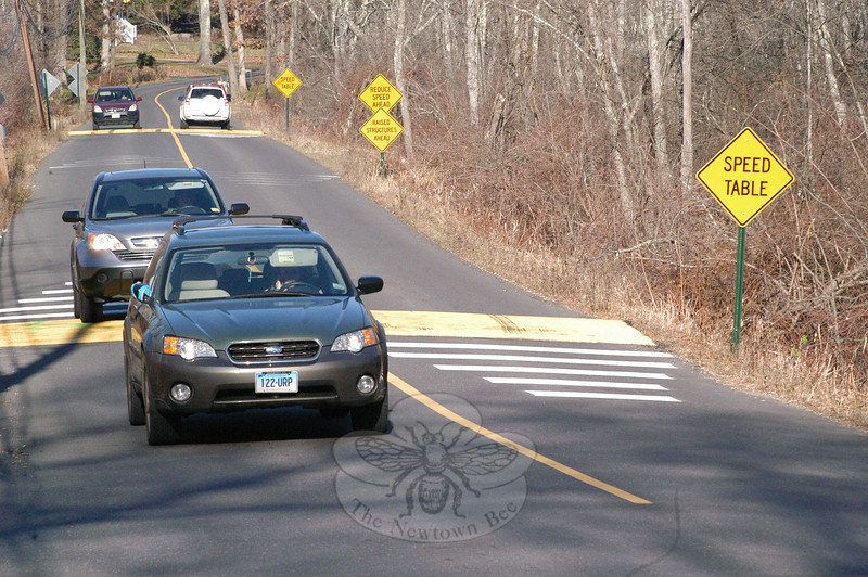 Vehicles traverse a section of Key Rock Road this week where two broad speed bumps, known as speed tables, have been installed by the town to hold down traffic speeds in the area, which has a posted 20-mph speed limit. The speed tables are installed on the northern section of Key Rock Road, between its intersections with Sugar Street and North Branch Road. The Police Commission, acting as the traffic authority, approved the installation of the permanent structures, following tests held there with temporary structures in the fall of 2010.  (Gorosko photo)