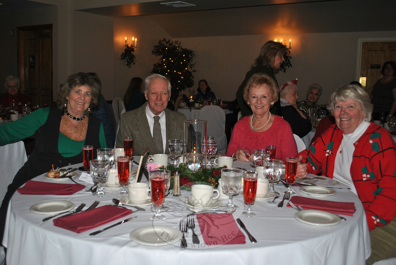 Newtown First Selectman Pat Llodra, second from right, joins Pat Shaw, Tom Dwyer, and Dot Dwyer in celebrating the holiday season.  (Crevier photo)