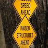 Key Rock Road has traffic signage posted warning motorists to keep down their speed because there are raised structures now positioned on the roadway.  (Gorosko photo)