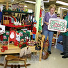 Like many of their career counterparts, the volunteers at Cornerstone Thrift Ministry at Newtown Congregational Church have surrounded themselves with Christmas… even if the big holiday is still six weeks away. Cornerstone volunteers recently spent a number of hours restocking the center with goodies for the holiday. There are shelves and bookcases filled with decorative items and home accessories, including dining and serving ware, Nativity scenes/crèche sets, Christmas cards, candles and candleholders, red and green clothing, and all kinds of goodies you never knew you needed, like a decanter with a cow wearing a wreath and reindeer antlers. Bobbe Bowles, left, and Judy Craven are the volunteers of Cornerstone, which also offers clothing, books, toys and more, all with very low suggested donations. Cornerstone Thrift Center, located in the lower level of the church, is open Tuesday through Friday from 11 am to 4 pm, and Saturday 11 am to 1 pm.  (Hicks photo)
