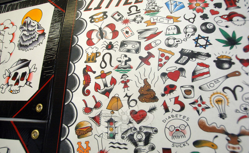 Images of tattoos clutter the walls of Hat City Tattoo in Danbury.  (Bobowick photo)