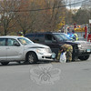 At 3:16 pm Friday, November 5, Hook & Ladder was dispatched to Queen Street on a reported motor vehicle accident, without injuries, near the signal light for Queen Street Shopping Center. Firefighters found a collision had occurred between a Jeep Grand Cherokee and a Chrysler PT Cruiser. Speedi-Dri was applied to the roadway, to soak up fluids that had been spilled from the vehicles. Six days after the accident, Newtown Police still had no additional details available concerning this incident.  (Hutchison photo)