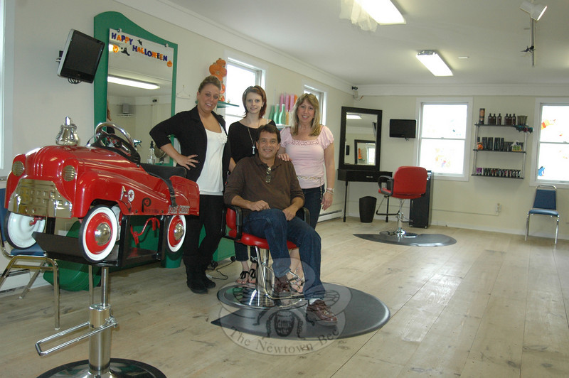 From left, Fun Kuts stylists Lorin Fraser and Kristi Parsell stand with owners Marci and Felix Benitez. The popular hair salon has moved and expanded to include Fun Kids Consignments, all under one roof at 111 Church Hill Road.  (Voket photo)