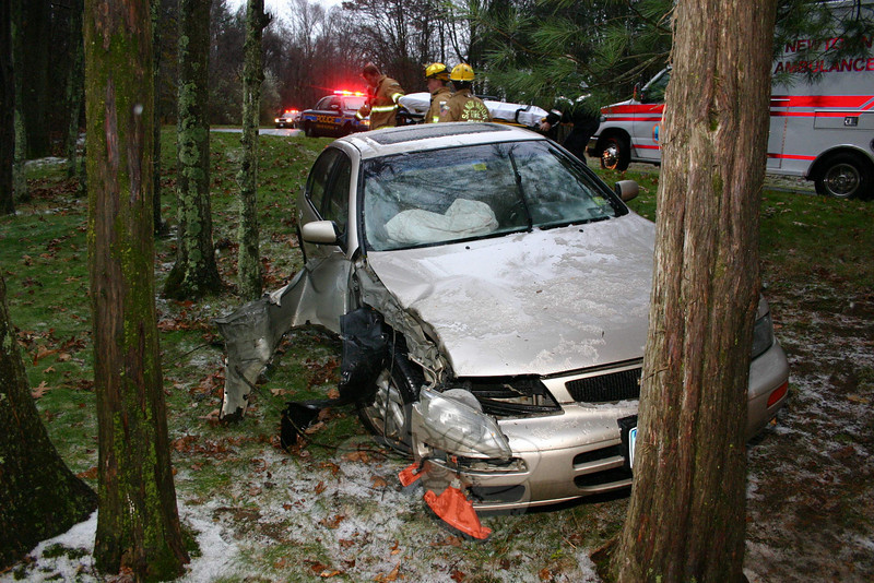 An 18-year-old female lost control of her vehicle Monday morning, presumably in part due to the slippery weather conditions of the season's first wintry storm. The driver of this vehicle had been traveling north on Cobblers Mill Road in Sandy Hook when the car went off the roadway and stuck a pair of trees before coming to rest in the yard of 18 Cobblers Mill Road. Sandy Hook firefighters and Newtown Ambulance responded to the scene. The driver was transported to Danbury Hospital.  (Hicks photo)