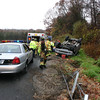 Sandy Hook and then Hook & Ladder fire companies were dispatched at 10:24 am Friday, November 5, to a reported one-vehicle rollover with injuries on the I-84 Exit 10 westbound onramp. Newtown Ambulance and the on-call medic were also sent to the scene, where responders found a Jeep Grand Cherokee Laredo had rolled over from the wet roadway, striking the guardrail and landing on its roof. A female driver and young male passenger had been able to remove themselves from the vehicle, but had to be treated for injuries. Both were transported to the hospital. Further details on the accident were unavailable at press time from the Connecticut State Police.  (Hicks photo)