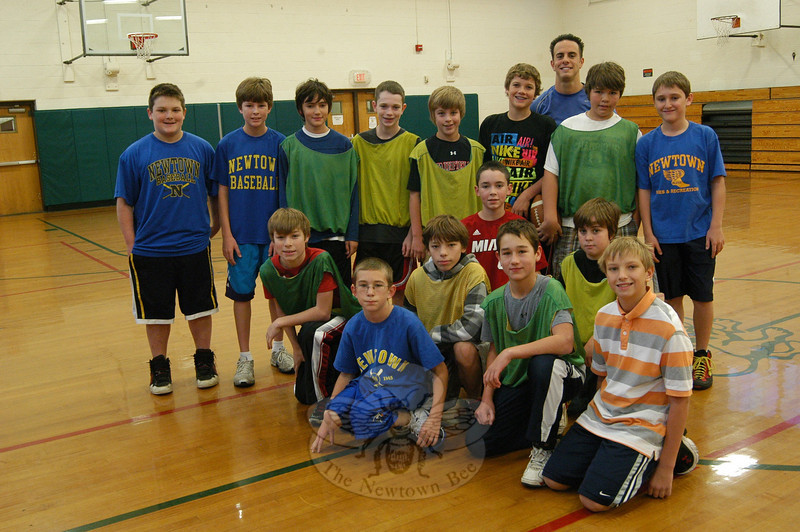 Newtown Middle School physical education teacher Matthew Memoli stands with students participating in the Zero Hour Physical Education program on Tuesday, November 9.  (Hallabeck photo)