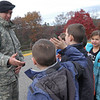"As multiple schools in Newtown were preparing for Veterans Day ceremonies and activities scheduled for November 11, Middle Gate Elementary School welcomed two representatives from the Danbury US Army Recruiting center on Wednesday, November 10. Sergeant Derek Brookshire and Sergeant Samuel Dolan, above with students, gave presentations and answered questions during the school's ""Veterans Day Celebration."" Event overseer Linda Baron said the program was held at the school roughly eight years ago, and this year the school wanted to ""just really make it glorious."" Ms Baron also said the program was held to give students a sense of who soldiers are. ""It's so important that these kids know who serves our country,"" she said. The event was one of multiple at the school as a buildup to its Thursday Veterans Day ceremonies.  (Hallabeck photo)"
