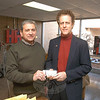 Rick Mazzariello of The Newtown Fund, left, accepts a check as a donation from Newtown Rotary Club President-Elect Mike Toll for The Newtown Fund's Depot Day activities at Sandy Hook School.  (Gorosko photo)