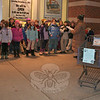 "Third and fourth grade students from Housatonic Valley Waldorf School spent two cold hours outside The Big Y on Monday night, singing traditional holiday songs from a number of different cultures. The children, directed by third grade teacher Amalia Pretel-Gray and fourth grade teacher Marybeth Thomas, sang from 4:30 until 6:30 on December 19, welcoming shoppers as they headed into the supermarket. Shoppers gave the children — who stopped a few times for warm snacks — a very positive response, said HVWS Enrollment Director Therese Lederer. ""We'd love to make this a holiday tradition,"" she said.  (Hicks photo)"