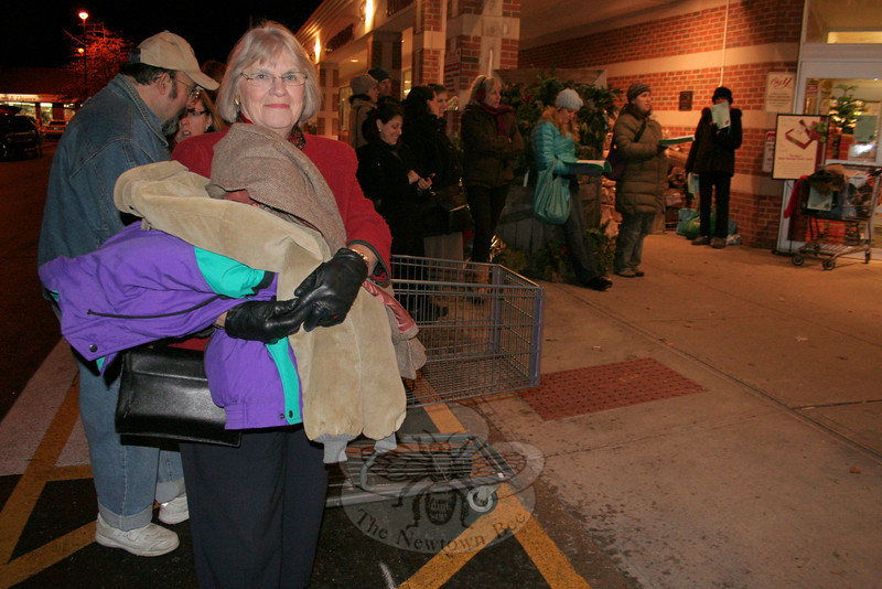 Janice Garten arrived at The Big Y with a handful of coats to donate. Children from The Housatonic Valley Waldorf School were collecting new and gently used coats while they sang Christmas carols Monday night, and were going to donate the collected outerwear to the Danbury Women's Shelter and The Dorothy Day Hospitality House, also in Danbury. The first-time event generated a collection of just over 60 coats, according to HVWS Enrollment Director Therese Lederer.  (Hicks photo)